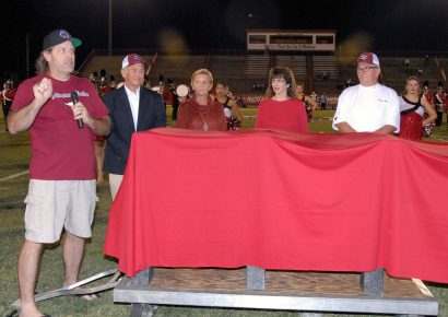 If Heaven Can Send Smiles, Coach Henderson Had a Big One Friday; Benches Dedicated in his Memory