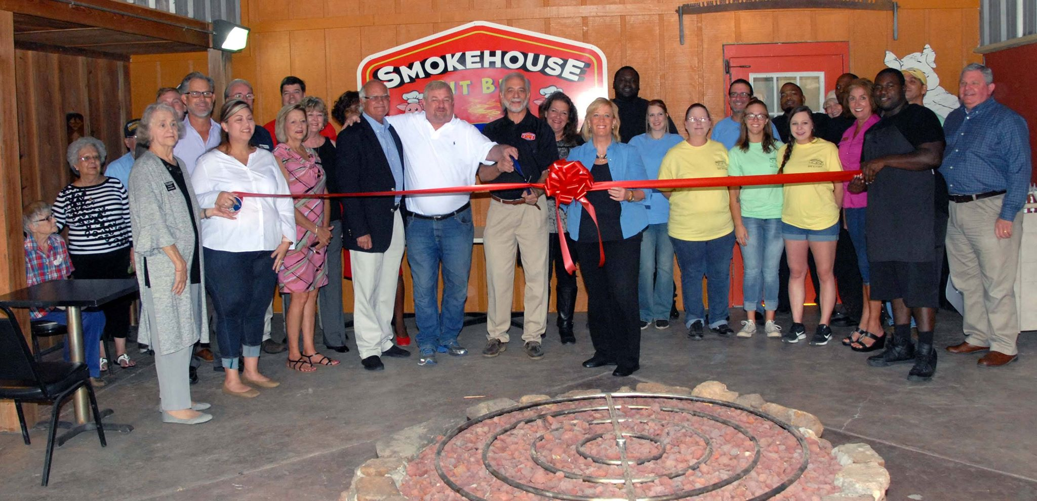 City officials and the Millbrook Area Chamber of Commerce welcomed the Smokehouse Pit Barbecue to the city Oct. 8